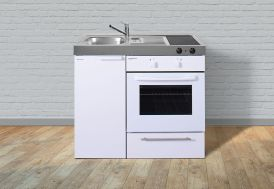 Kitchenette équipée en métal blanc avec four, frigo et plaque de cuisson